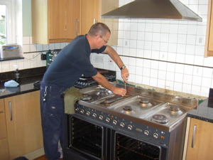 The engineer, Steve, repairing a Britannia cooker